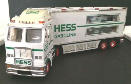 Vintage 2003 Hess Toy Truck and Racecars. Back again is the impressive eighteen wheeler with two sleek open-wheeled racecars. Three toys for the price of one is back! And the race cars have drivers with helmets that speed off with their pull-back motors. The double decker ramp inside the back of the trailer is very cool.
