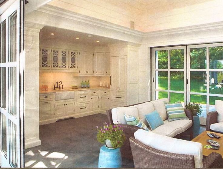 Garage Conversion Ideas with Vintage Kitchen Island and Kitchen Cabinet also Classic Rattan Sofa