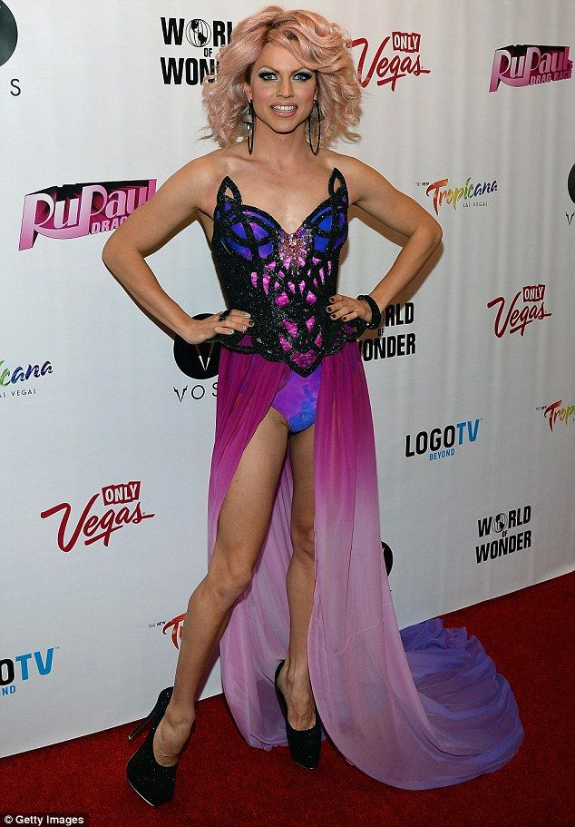 Drag queen style: Australian performer Courtney Act (real name Shane Jenek) dazzled in a pink and purple revealing number at the RuPaul's Drag Race finale viewing party in Las Vegas last Monday