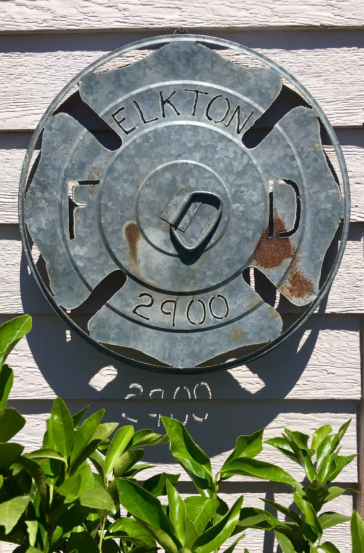 Maltese cross firefighter / fire department design plasma cut into galvanized garbage can lid. Design 1 of 2.  Made by Roshi