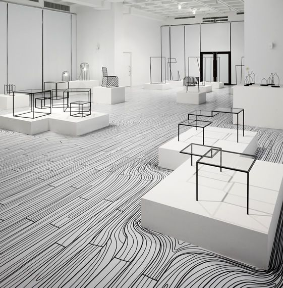 Nendo Exhibition - floor pattern  flooring goes w furniture. Different levels for exhibiting work