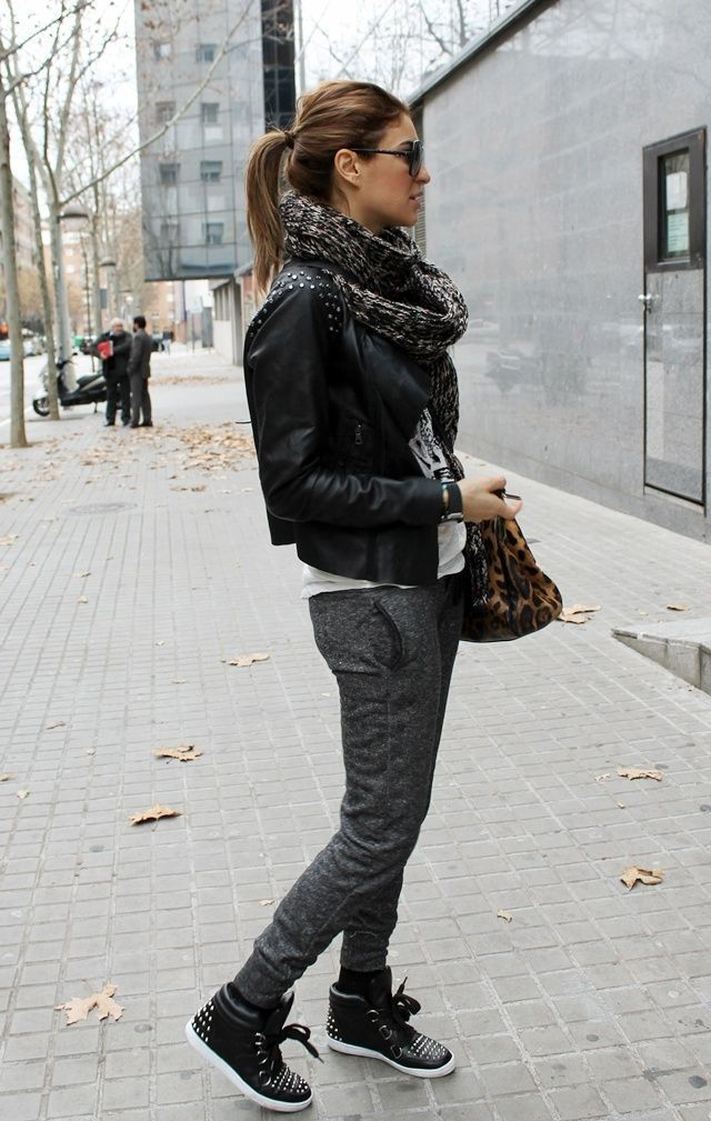 Shop this look on Lookastic:  https://lookastic.com/women/looks/biker-jacket-crew-neck-t-shirt-sweatpants-high-top-sneakers-tote-bag-scarf-sunglasses/5904  — Black Sunglasses  — Charcoal Knit Scarf  — Black Studded Leather Biker Jacket  — White and Black Print Crew-neck T-shirt  — Brown Leopard Suede Tote Bag  — Charcoal Sweatpants  — Black Leather High Top Sneakers