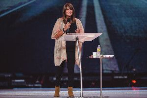 Bobbie Houston from Hillsong Church with a Procson Pulpits Arc2 lectern and table. Colour Conference, Sydney 2015.