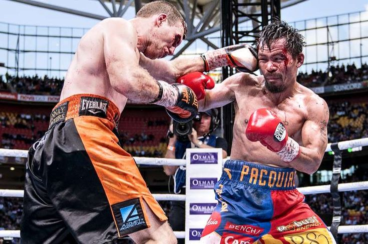 Sports Illustrated's 100 Best Photos of 2017 - December 14, 2017:  JEFF HORN, MANNY PACQUIAO (RIGHT) | WBO WELTERWEIGHT TITLE FIGHT