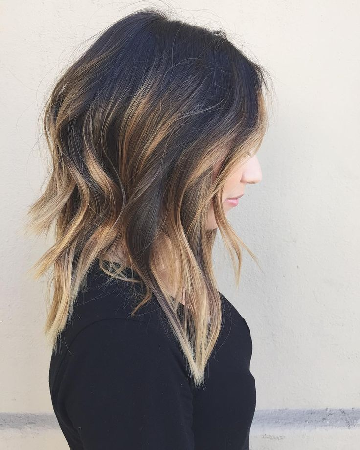 black layered hair with caramel balayage