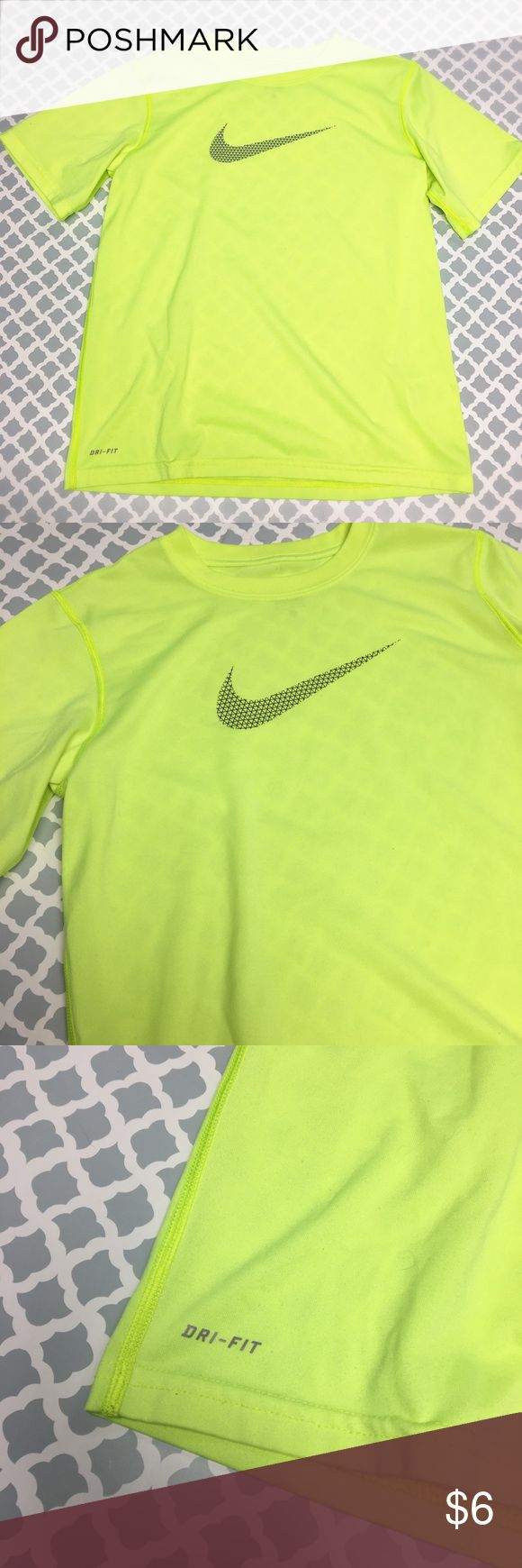 Nike Drifit T Shirt Boys size Large 🔘Description: Nike Drifit Neon yellow logo T shirt boys size large  🔘Condition: Excellent    🔘Measurements:       Pit to Pitt -        Shoulder to Hem -                 Inventory:    ⭐️ 15% Off All Bundles! 🛍    💞Thanks for stopping by! 😘 Nike Shirts & Tops Tees - Short Sleeve