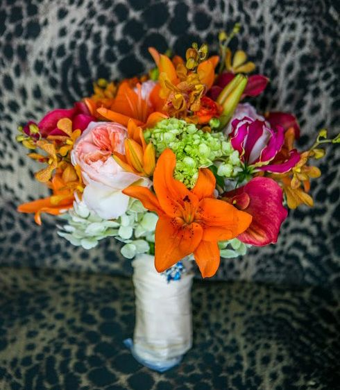 Asiatic & Gloriosa lilies, peonies, & orchids.  (Flowers by Lee Forrest Design,  photo by: David Gaik)