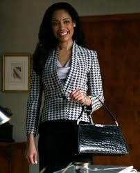 Gina torres as Jessica Pearson in 'Suits'. Stella McCartney Houndstooth Jacket, Armani Shirt, L'Wren Scott Skirt.