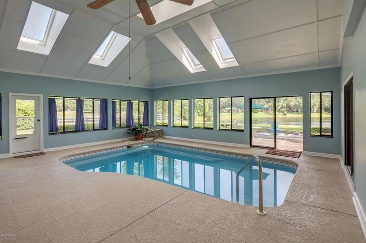 Traditional Swimming Pool with exterior stone floors, Indoor pool
