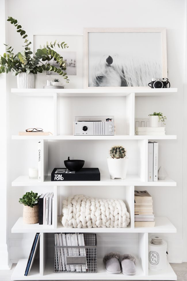 Beautiful shelves with shades of white, cream, black and green.