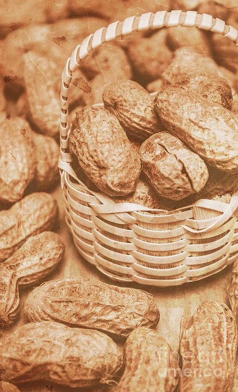 Closeup toned image of peanuts in small wicker basket. Groundnuts still-life by Jorgo Photography - Wall Art Gallery