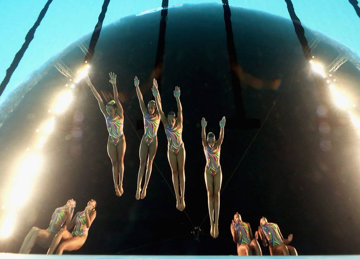 Spain dives in during the Synchronized Swimming Team Technical, preliminary round on day three.