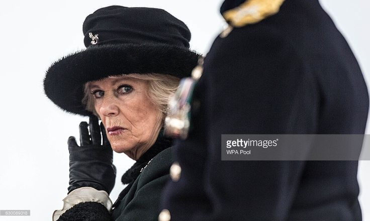 The Duchess of Cornwall watches the parade of graduating officer cadets during The Sovereign's Parade at Royal Military Academy Sandhurst on December 16, 2016 in Camberley, England. Today is the first time The Duchess has represented Her Majesty The Queen at the annual event that marks the passing out of Officer Cadets on completion of their Commissioning Course.