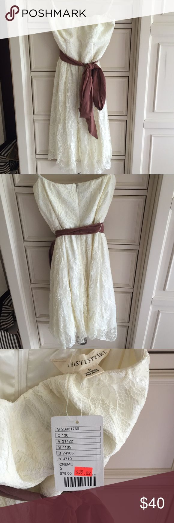 White lace strapless dress with brown ribbon belt White lace strapless dress with a brown ribbon belt perfect for summer BBQs. Urban Outfitters Dresses Strapless