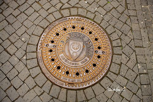 Manhole cover - Duitsland, Halle, manhole, manhole cover, stan de haas, kanaldeckel, gullydeckel, asphalt, background, circle, city, cover, detail, drain, grate, gray, hole, iron, metal, old, pavement, road, round, sewage, sewer, sidewalk, steel, street, symbol, underground, urban, water, putdeksel  http://www.standehaas.com  https://www.facebook.com/pages/Stan-de-Haas-Photography