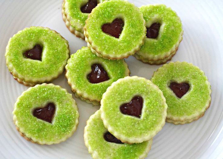 These Grinch Heart Raspberry Filled Sugar Cookies are perfect for Christmas and so easy to make. Made with a homemade sugar cookie dough or store bought