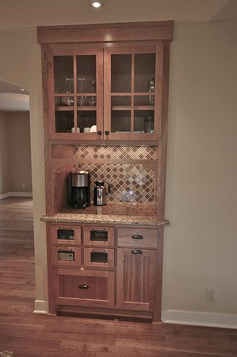 Replace existing dining room bar closet with a combined coffee station/bar, matching the kitchen cabinets. This is genius... Plus we could plumb in a small bar sink since the water lines are in the wall already for the tub in the bathroom!