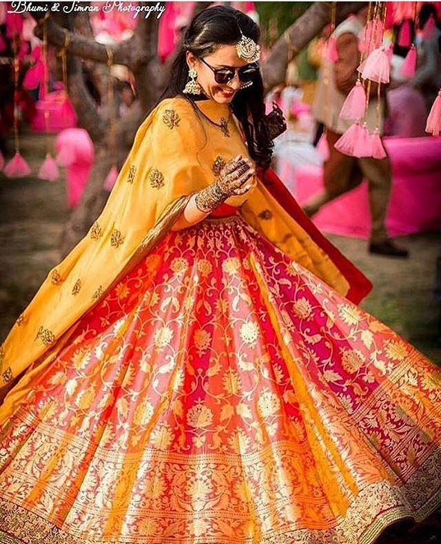 The Banarsi twirl!  Photo by @bhumiandsimran  #weddingplz  #weddingphotography #photooftheday #instabride #bridalwear  #ootd #pink #yoursinweddings #instaweddings #fun #indianbride #instamood #jewellery #lehanga #indianwedding #weddings #twirl