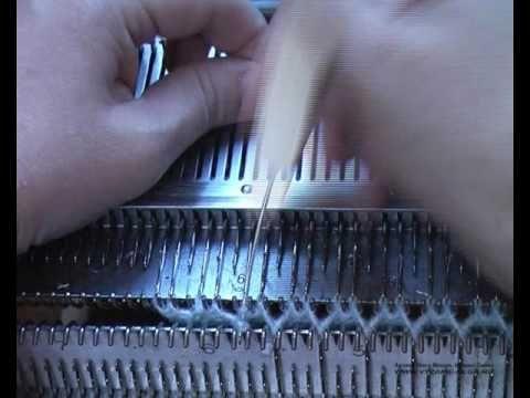 Шапочка двойная у отворотом и ушками.В видео показан рассчет шапки, вывязывание ушек, как соеденить два полотна в процессе вязания. Также как связать шнурки-...
