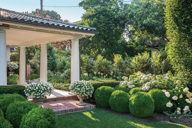 """The Side Yard - Small Space Garden, Big Impact - Southernliving. Transform leftover space with elegant white.     The Big Idea: Transitional spaces such as side yards are often treated as service areas, holding little more than garden hoses and trash cans. Elevate yours by turning it into a feature, as Loi and Tom did. """"The side yard, or white garden, was planted as a refuge from busy city life,"""" says Loi. Inspired by the famed White Garden at Sissinghurst Castle in England, the relaxed…"""