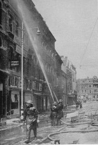 The Auxiliary Fire Service in action in Old Town Street, Plymouth, during the Blitz.