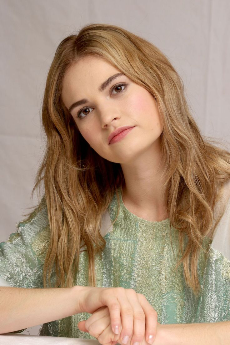 LILY JAMES at Cinderella Press Conference in Beverly Hills ...
