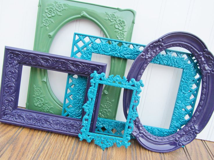 I like the idea of getting decorative frames-- no matter how gaudy-- from second-hand stores and painting them solid colors.