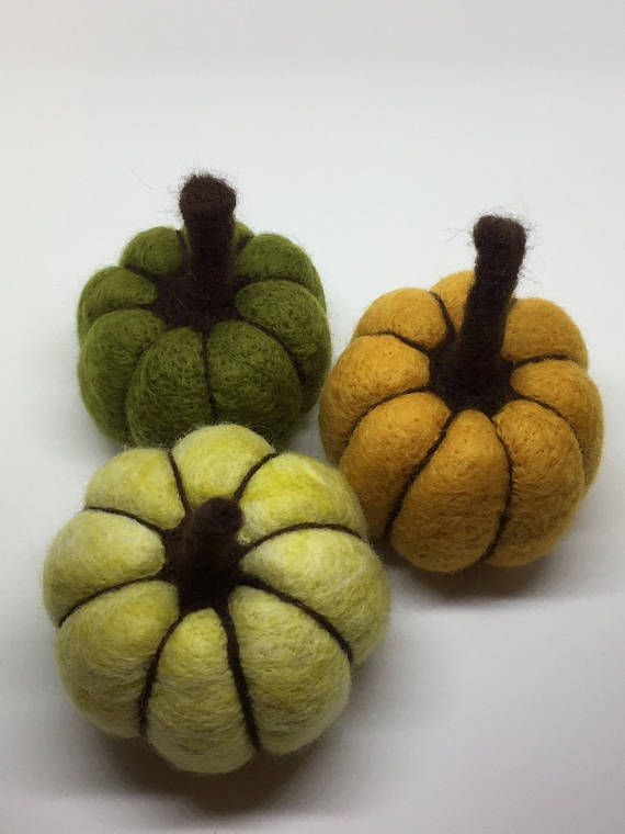This listing is for a small hand needle felted decorative pumpkin in shades of green and brown.  The pumpkin measures approximately 7cm in height and approximately 6cm in diameter.  This piece is part of a larger series of works celebrating the seasonal colours, forms and animals of Autumn. The pumpkin itself is small, round and plump; being needle felted it also has a wonderfully soft and tactile quality. Its earth tones are warm and rich; reminiscent of cosy autumnal evenings spent in…