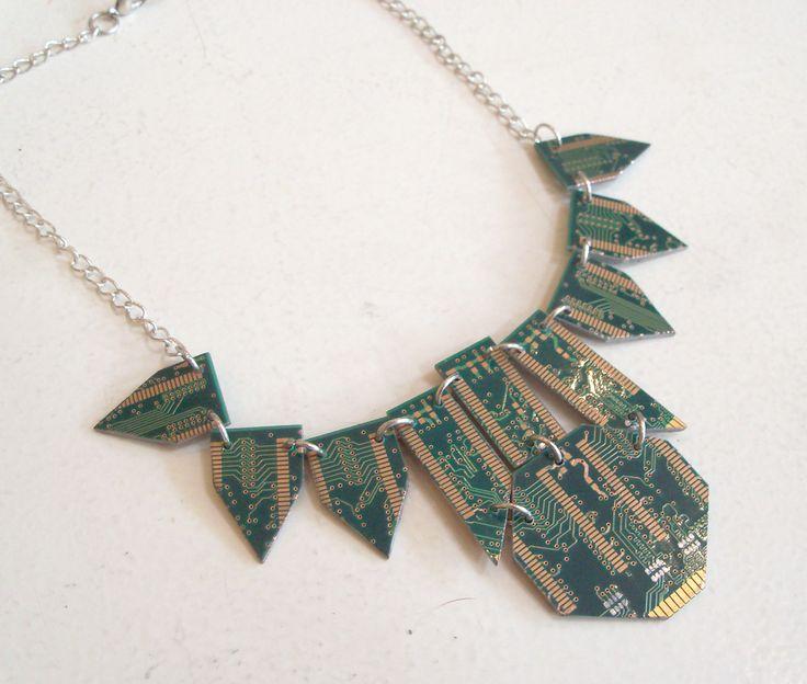 Aubrey Situ- using computer parts Aubrey makes contemporary Jewellery designs. At: Artisan Gallery, 344 Florida Road. Ph: 031 312 4364. Email: info@artisan.co.za