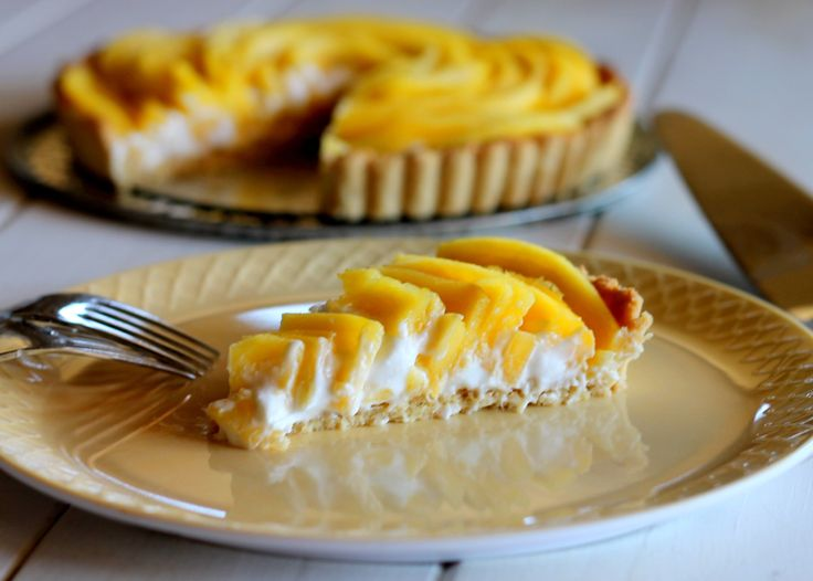 This Mango Tart uses fresh, ripe mangos and coconut cream to make a delicious dessert that's gluten-free, Paleo friendly, refined sugar-free, and vegan! The recipe includes step by step photos for how to make a beautiful mango flower.