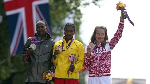 Medallists pose after women's Marathon  (L-R) Silver medalist, Priscah Jeptoo of Kenya, gold medalist Tiki Gelana of Ethiopia and bronze medalist Tatyana Petrova Arkhipova of Russia