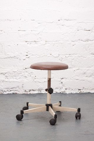 Swivel stool with brown leather seat.  If you like this check out our shop http://industrialthings.com/