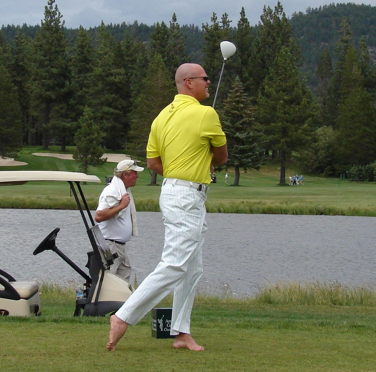 Jim McMahon tees off during a practice round at Edgewood Tahoe on Thursday, The former Super Bowl winning Chicago Bear QB plays each round without shoes. (July 2012)
