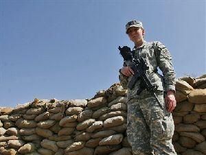 Spc. Monica Lin Brown from Lake Jackson Texas  stands guard at a forward operating base in Khost, Afghanistan. She's only the second woman to be awarded the Silver Star for  bravery in combat since World War II.   (AP Photo/Rafiq Maqbool)
