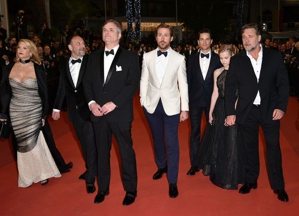 "(FromL) US producer Joel Silver and his wife US producer Karyn Fields, US director Shane Black, Canadian actor Ryan Gosling, US actor Matt Bomer, Australian actress Angourie Rice and New Zealander actor Russell Crowe arrive on May 15, 2016 for the screening of the film ""The Nice Guys"" at the 69th Cannes Film Festival in Cannes, southern France. / AFP / ALBERTO PIZZOLI"