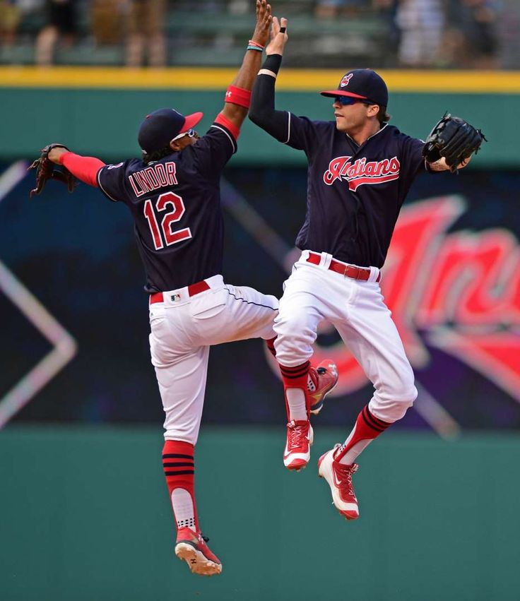 High Five:    Tyler Naquin, right, and Francisco Lindor celebrate after Indians defeated Blue Jays, 3-2, in a baseball game on Aug 21 in Cleveland.