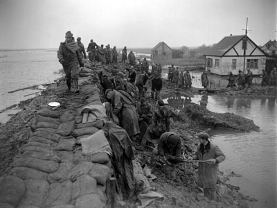 (Canvey Island) She survived this....Civilians and troops fill sandbags to block a breach in Canvey Island's sea defences, following the greatest surge on record for the North Sea. Between January 31 and February 1 1953, almost 100,000 hectares of eastern England were flooded and 307 people died.