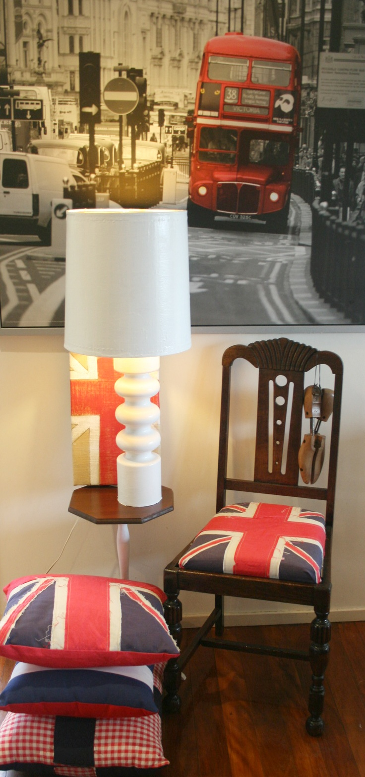 Union Jack cushioned vintage chair with bespoke Union Jack cushions and burlap artwork, retro lamp, Ikea London Bus print and vintage shoe trees.