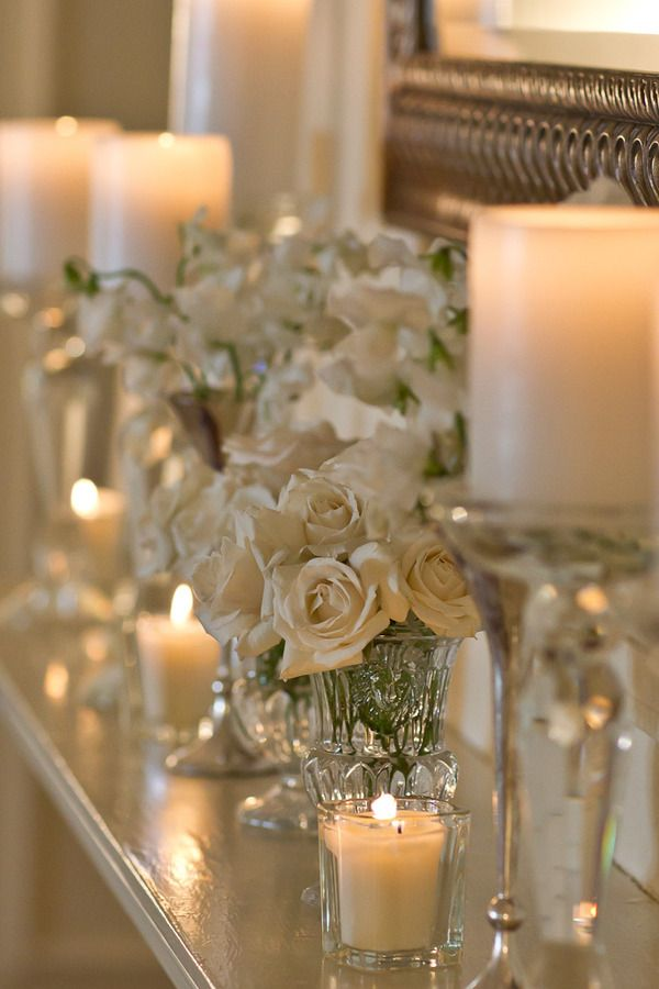Beautiful cut glass vases with roses, tons of candle glow- so romantic!