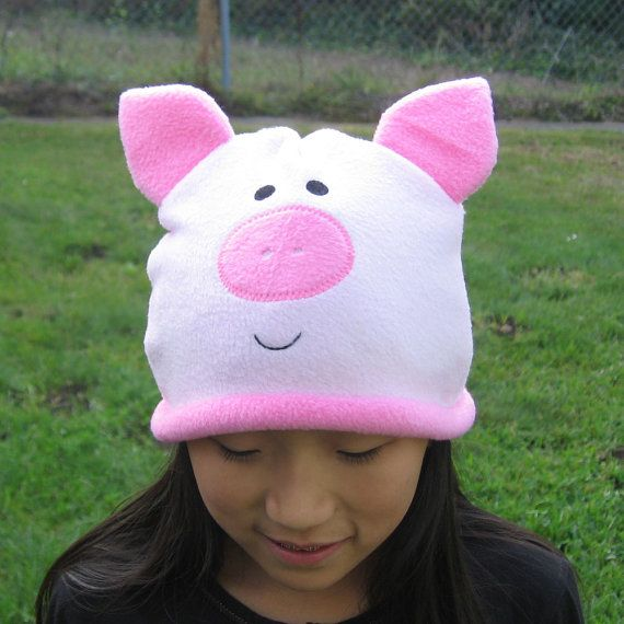 Pig Hat-Sew a pig nose and pig ears onto a pink beanie hat for Aaron's halloween costume. Get a pink sweat suit, sew a pink circle belly onto the sweatshirt. Make a curly pig tail.