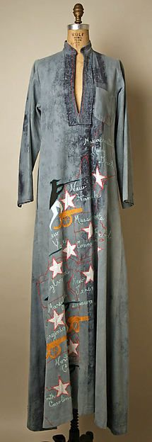 This is a Caftan. Caftans were an item of traditional African dress, which became popular in the 1970s. This one is made of blue cotton denim and was made in 1977 by Serendipity 3.