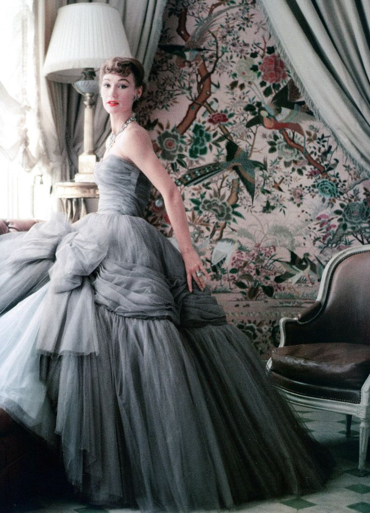 """In the sun room of Dior's house in Passy, Sophie Malgat wears the newest of Dior's """"big"""" ball gowns, the skirt has 12 layers and is separate from the bodice because of its weight, photo by Mark Shaw, 1953  Sophie Malgat - the wife of the film director Anatole """"Tola"""" Litvak - was one of the rare models who starred on the catwalk and had """"cover girl"""" status in magazine editorials. """"Sophie knew how to move in clothes and how to pose,"""" says Brigitte Tortet. """"She defined truly elegance"""""""