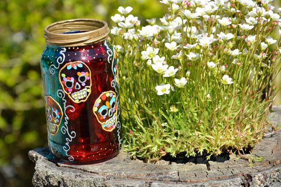 SUGAR SKULL ART Hand painted Mason Jar, Jam Jar, Day of the Dead light, Halloween Candle, Small Candle Lantern, Wedding Table, Holiday Gift, Stocking Filler, Glass Painting, Garden Art Shown here in turquoise & pink, but can be painted in a wide range of colours See it at the Ornately Lanterns' Etsy shop:  https://www.etsy.com/uk/shop/OrnatelyLanterns