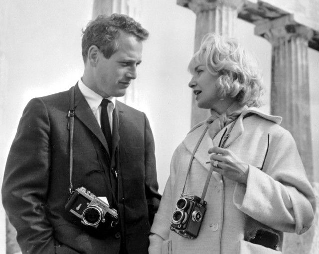 Paul Newman with a Nikon F and Joanne Woodward with a Rollieflex.