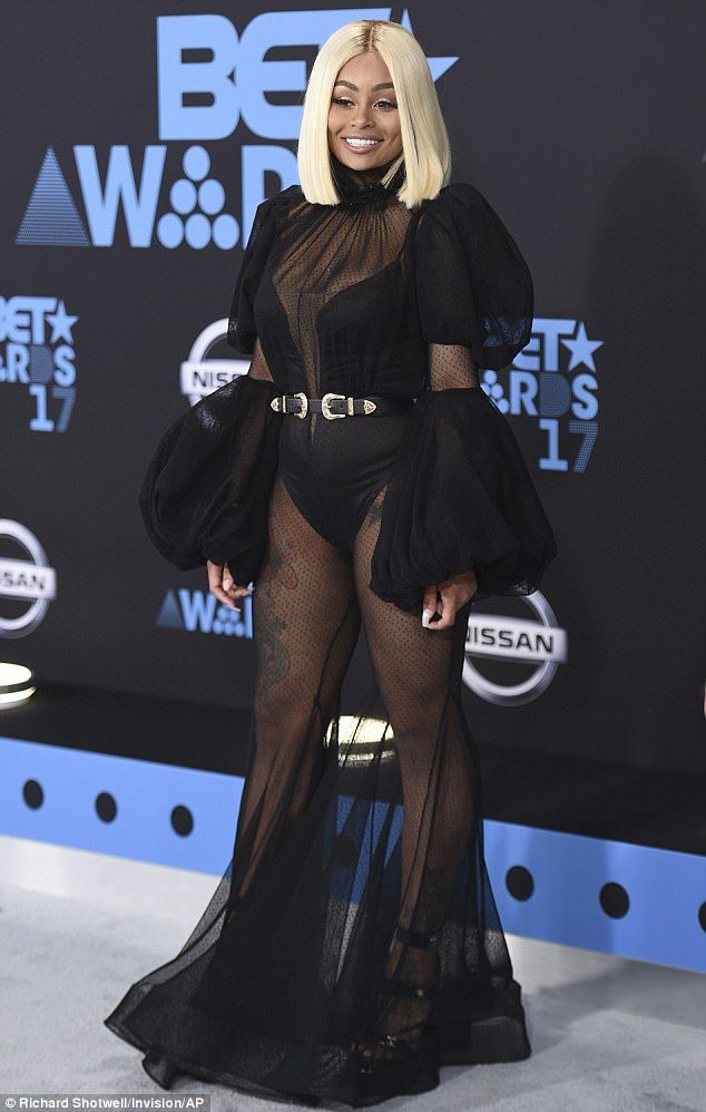 Not going easy on the night, Blac Chyna gave her fans an eyeful of her cleavage and derriere as she rock the BET Award Red carpet in a b...