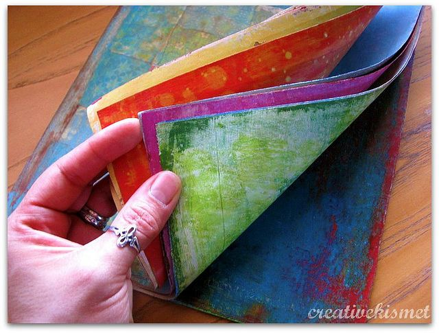 Art journal created with red rosin (hardware store) paper. This would be an awesome art journal for kids.