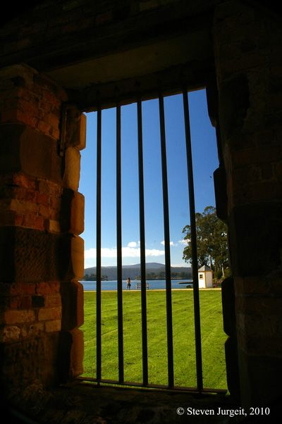 Tasmania, Port Arthur Penitentiary. View of the Port Arthur harbour from this prison window .