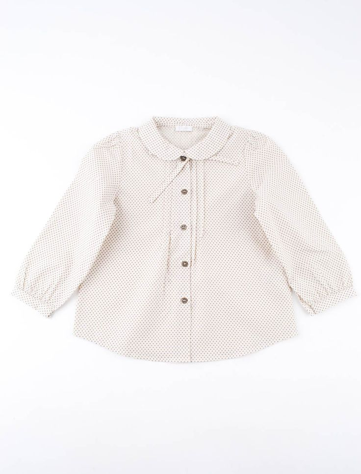 Refined blouse by Il Gufo with gray polka dots. Elegant model with pleats. The bow tie can be detached by means of a button behind the collar.