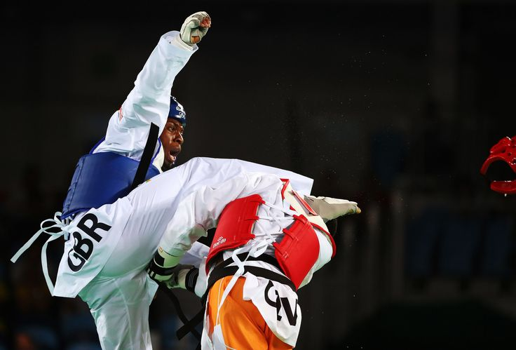 Lutalo Muhammad, left, of Britain, and Cheikh Sallah Cissé of Ivory Coast facing off in the men's 80-kilogram taekwondo final. Cissé prevailed, 8-6, to capture the gold medal.  Chang W. Lee/The New York Times