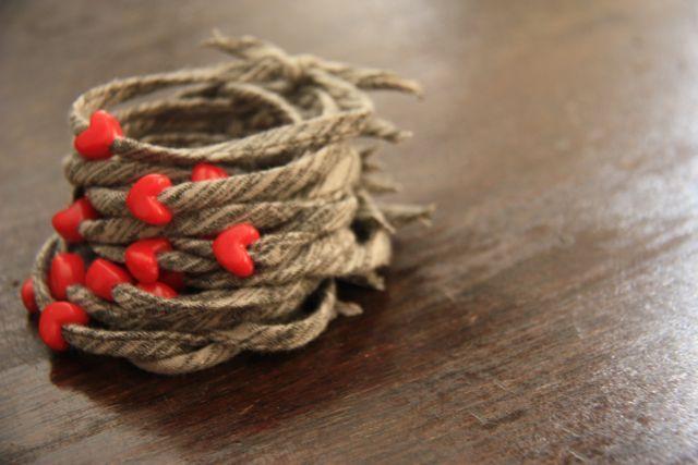 Simple bracelet = tshirt scrap + 1 bead via @thisiscarrie